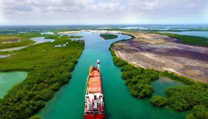 Tug escorting ship into the Port of Big Creek